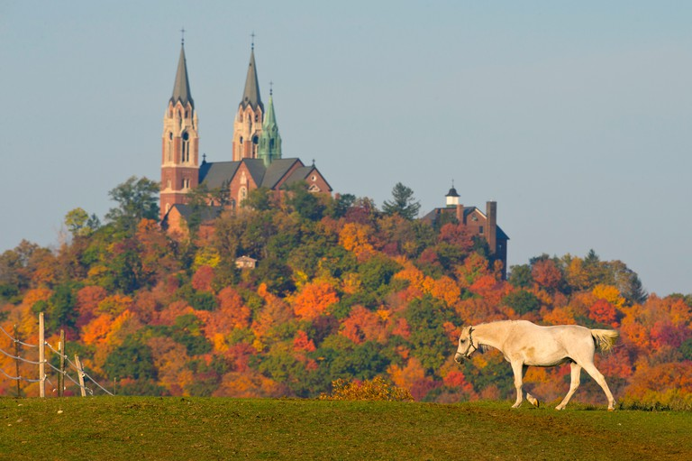 D2E2RG Holy Hill National Shrine to Mary rises in the background on a fall day in Hubertus, Wisconsin