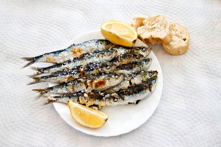 Sardines grilled on a stick.. Image shot 04/2013. Exact date unknown.