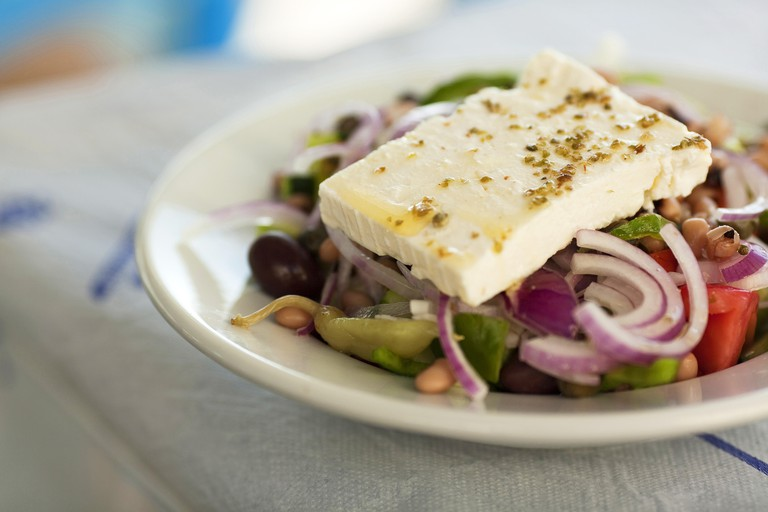 Greek Salad wiating to consume on the table, Koufonissi, Cyclades Islands, Greek Islands, Greece, Europe.