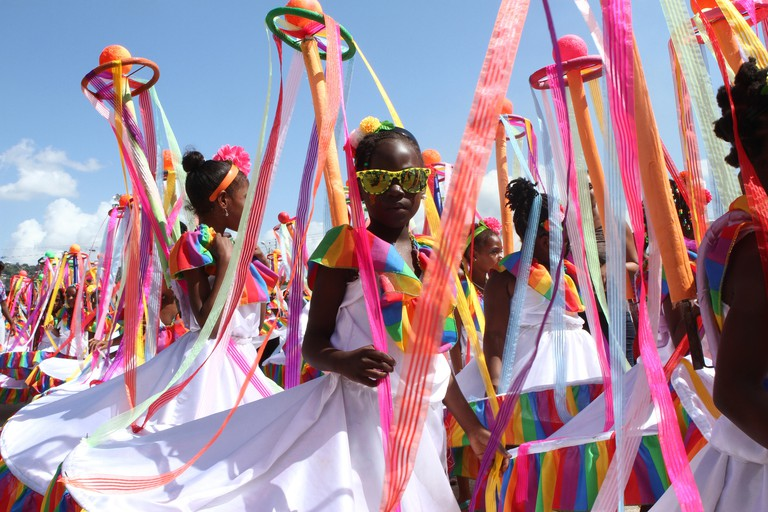 Young masqueraders perform  on Frederick Street during the Republic Bank Children's Carnival in Port of Spain, Trinidad.