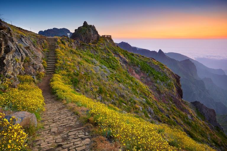 Mountain hiking trail from Pico do Arieiro to Pico Ruivo before sunrise, Madeira Island, Portugal