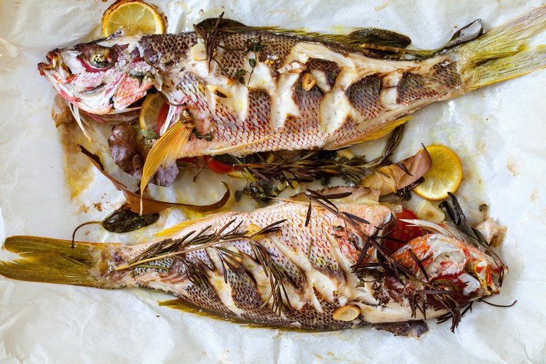 Roast red snappers with lemon, rosemary and garlic