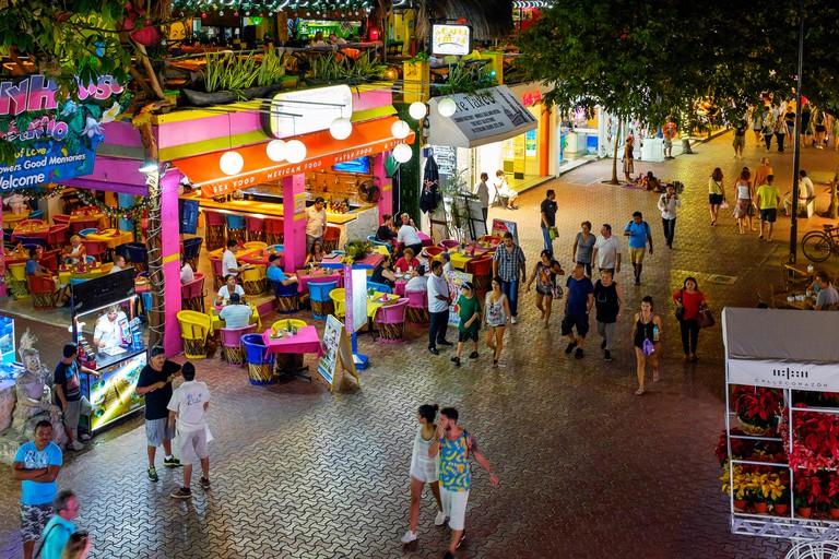 5th Avenue at Playa Del Carmen, Riviera Maya, near Cancun, Mexico.  At night showing some restaurants and bars.