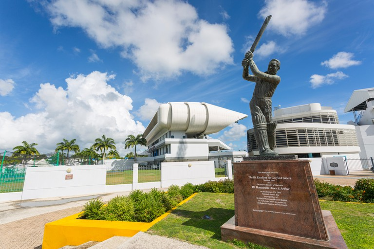 Garfield Sobers statue and The Kensington Oval Cricket Ground, Bridgetown, St. Michael, Barbados, West Indies, Caribbean