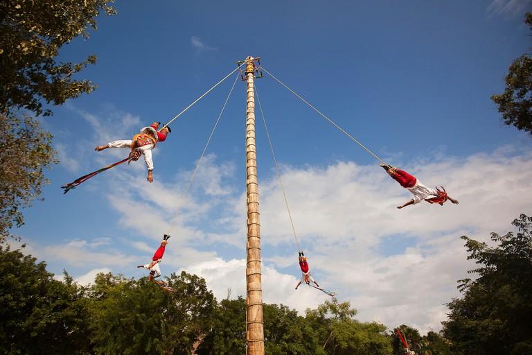 HMAKWD Papantla Flying Men-Voladores de Papantla Region during a performance in Xcaret Ecological Park near Playa del Carmen, Cancun, Quintana Roo, Yucatan