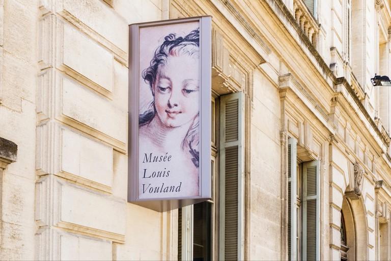 Musee Louis Vouland sign on the Villeneuve-Esclapon mansion facade housing the museum, Avignon, France