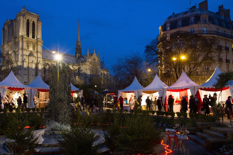 Christmas market at Square Rene Viviani along the banks of the Seine river across the Cathedral of Notre Dame in Paris France