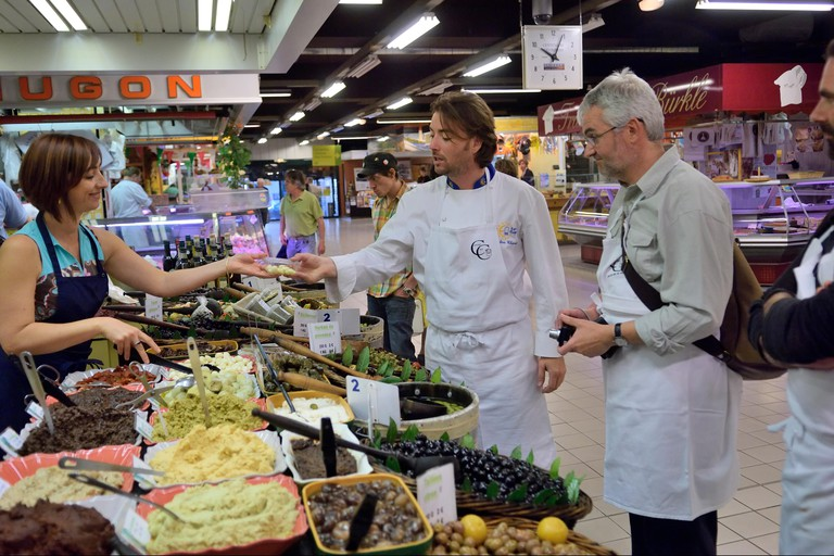 A cookery class tasting ingredients at Les Halles indoor market of Avignon, Provence, France