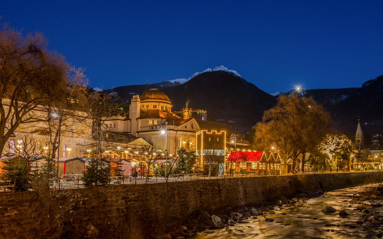 Meran Merano in South Tyrol, Italy, during the Christmas with christmas market by night . Beautiful light and great atmosphere