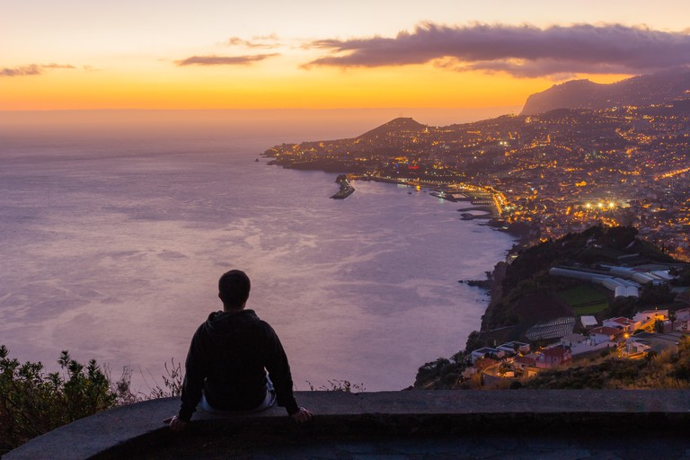 """MA81TR Sunset of Funchal city viewed from """"Miradouro das Neves"""" viewpoint, Madeira island, Portugal"""
