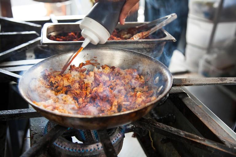 Cerdo adobado y arroz frito con kimchi (adobada pork with kimchi fried rice) being cookedDon Ramen, Telefonica Gastro ParkTijuana, Baja California,