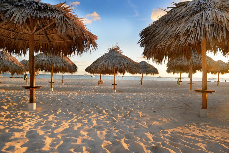 Amazing tropical holidays. Sun umbrellas on the beach. Tropical paradise. Caribbean. Punta Cana. Dominican Republic