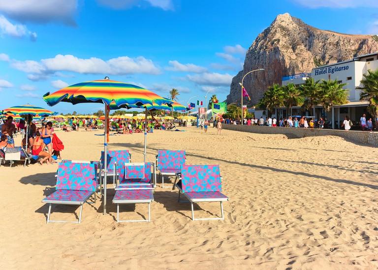 San Vito lo Capo, Italy - September 17, 2017: Sunbeds on the beach in San Vito lo Capo at the Mediterranean sea, Sicily, Italy