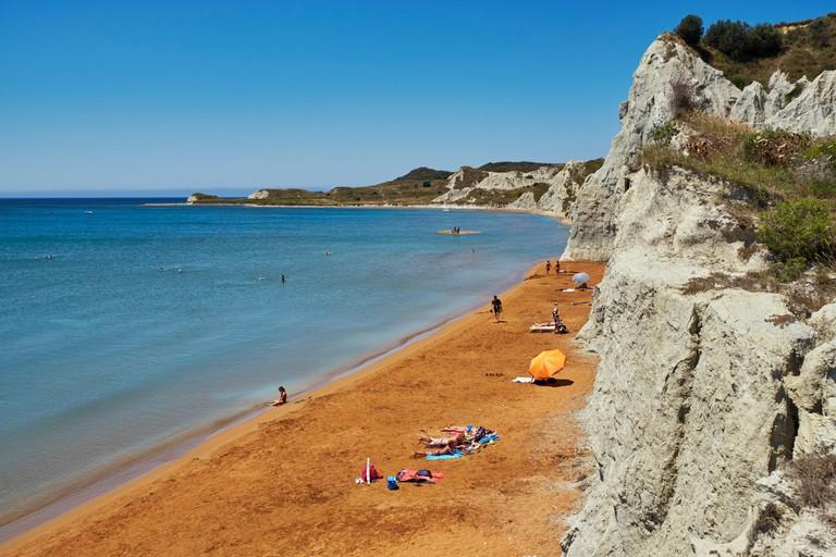 Red sand of Xi Beach on the Paliki Peninsula. Cephalonia, Ionian Islands, Greece.
