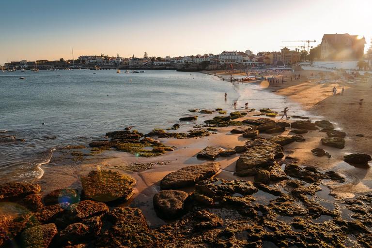 Long exposure of sandy beach in Cascais near Lisbon, Portugal during the summer. This beach is known as Praia da Conceicao