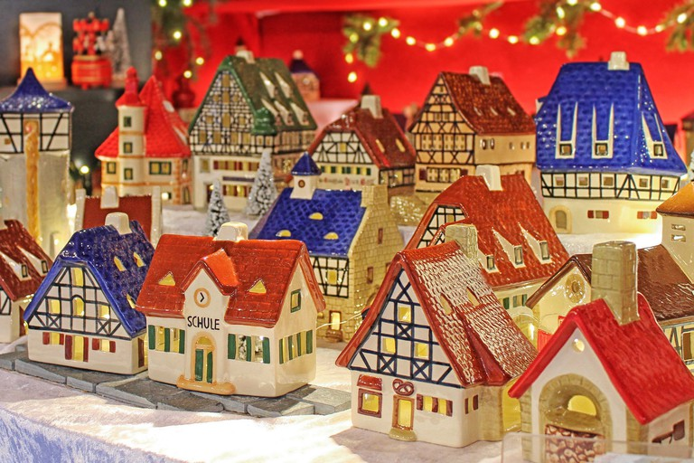 Christmas decoration on advent market. Decorative miniature city houses. Christmas market in Rothenburg ob der Tauber, Germany.
