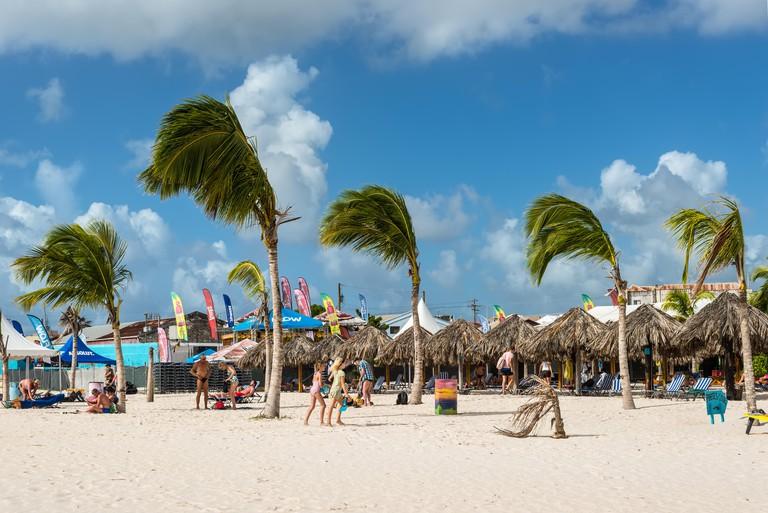 Bridgetown, Barbados - December 18, 2016: People relaxing on the Brownes beach at ocean coast at sunny day in Bridgetown, Barbados, West Indies, Carib