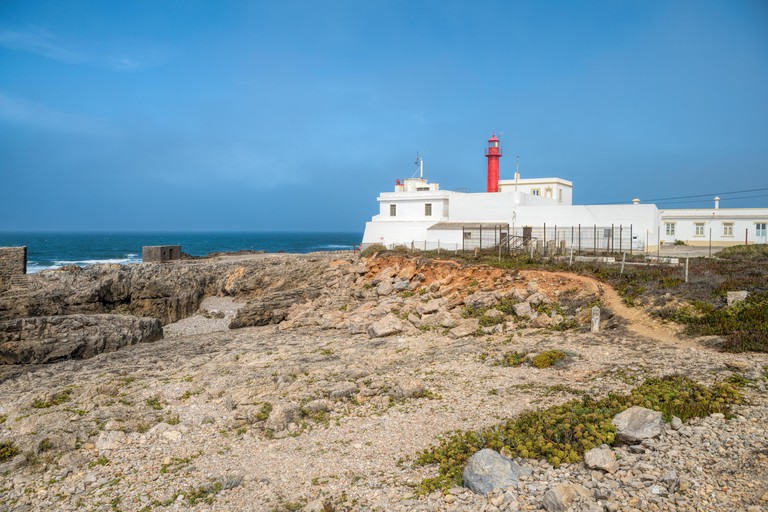 View with Cabo Raso lighthouse and fort of Saint Bras  near Guincho beach in Cascais area, Portugal.