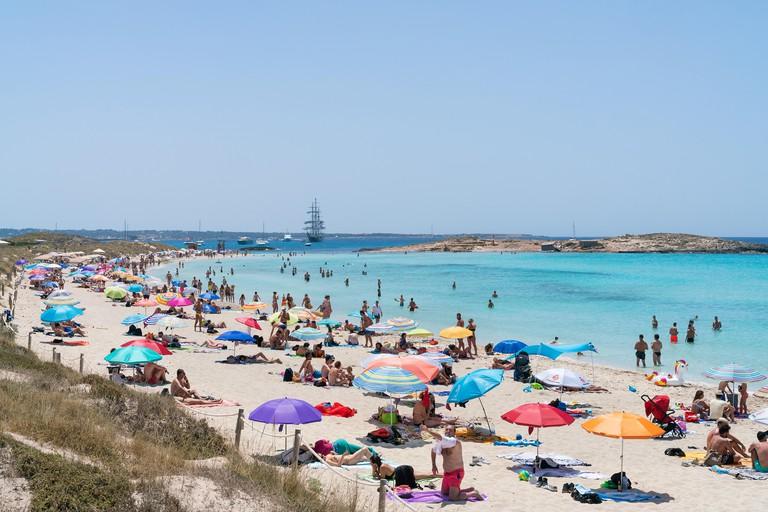 22th June 2019 - Formentera, Spain. People sunbathing on the Playa de Ses Illetes, Balearic Island of Formentera.