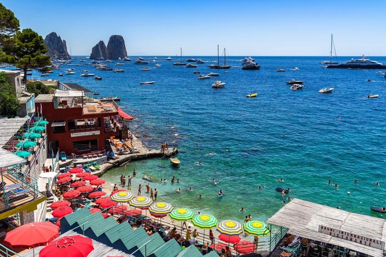 View of Marina Piccola, a pretty beach beach with a view of the Faraglioni. Capri, Campania, Italy,  June 2019