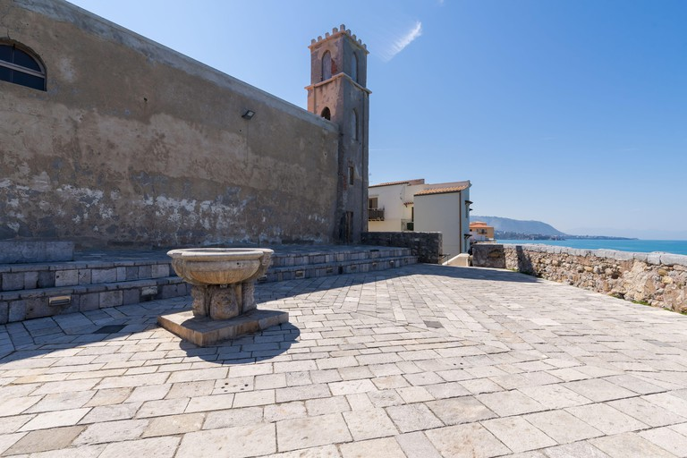 Bastione di Capo Marchiafava bastion lookout point in Cefalu empty on a sunny day in spring season - Sicily, Italy.