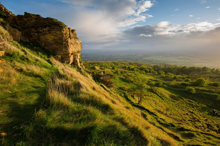 Limestone outcrop and countryside at Cleeve Hill on the Cotswold Edge, Gloucestershire, UK. May 2015.
