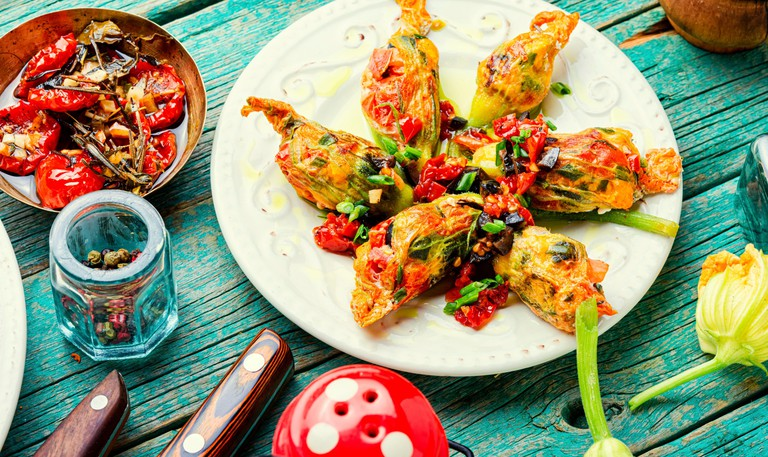 Delicious fried zucchini flowers stuffed with sun-dried tomatoes.Summer food.