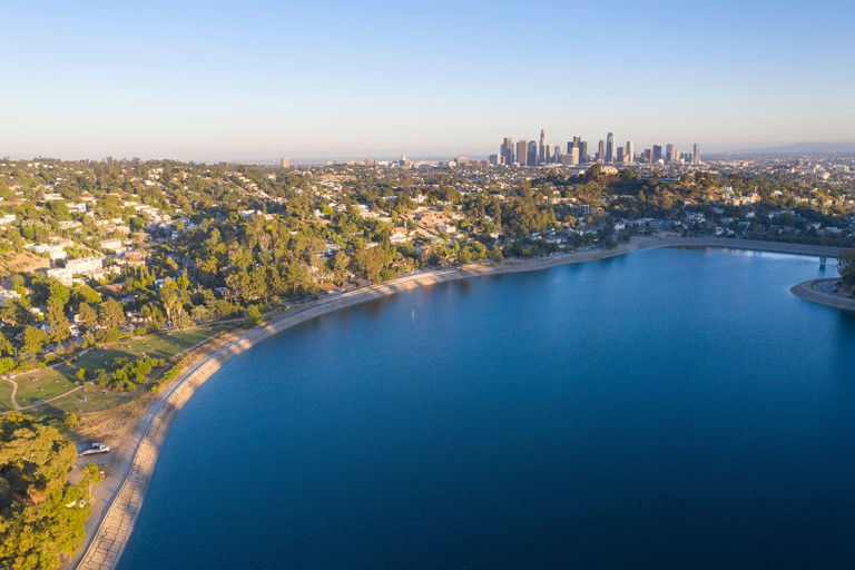 Aerial view of Silver Lake Reservoir with downtown Los Angeles skyline in the distance