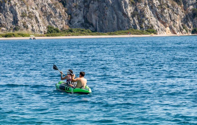 2C8BX0W People kayaking in the sea on one of the beaches in Greece