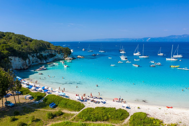 People relaxing at Voutoumi Beach, Antipaxos, Ionian Islands, Greece