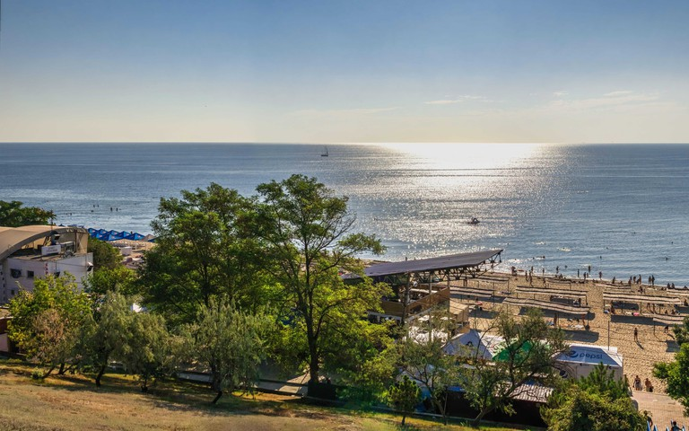 Chernomorsk, Ukraine 08.22.2020. Panoramic view of the Public beach in Chernomorsk city on a sunny summer morning