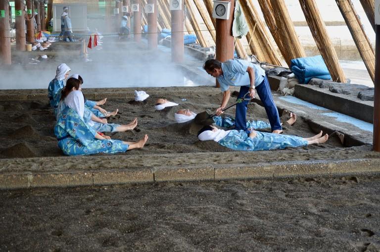 Bath of hot sand on the beach of the Ibusuki Sunamushi Onsen
