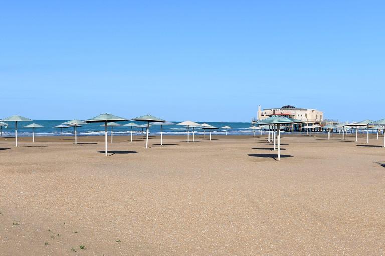 Shebeke Beach in the Caspian Sea, Azerbaijan. Multiple umbrellas at Bilgah Shebeke during low season.