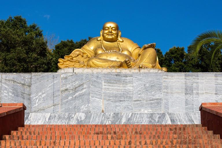 Buddha sculpture at Bacalhoa Buddha Eden, asian style garden, Quinta dos Loridos, Bombarral, Portugal, September 10, 2020