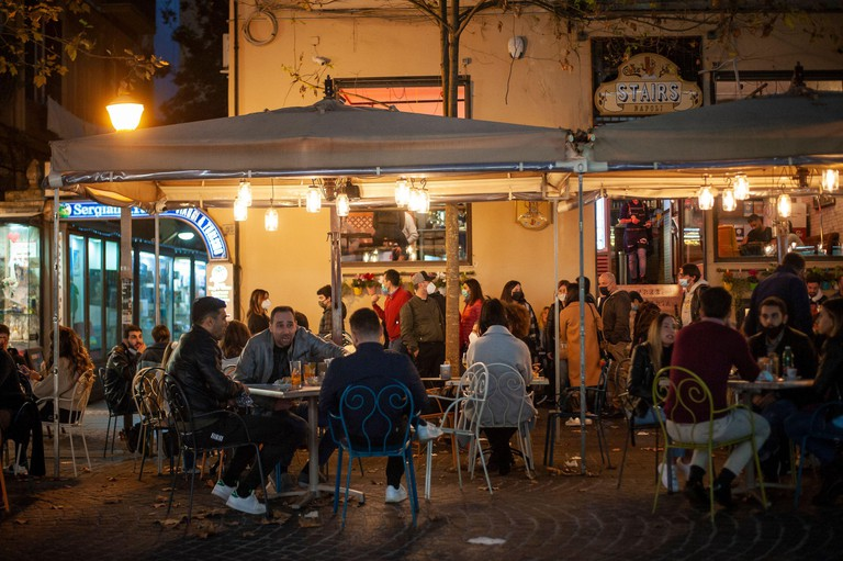 Napoli, Italy. 14th Nov, 2020. People seen sitting in a bar in Vomero district.Daily Life in trendy Vomero district before the starting of the closure for the red-zone in Naples Credit: SOPA Images Limited/Alamy Live News