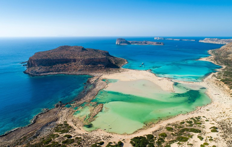 Aerial view over the clear waters at Balos Beach and lagoon - a popular tourist attraction on the northwest coast of Crete, Greece