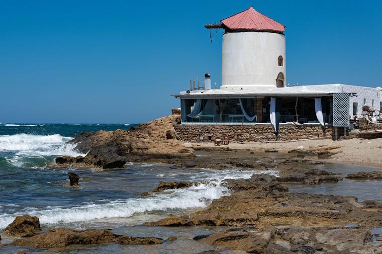 Restored windmill at a beach of Skyros island in Greece