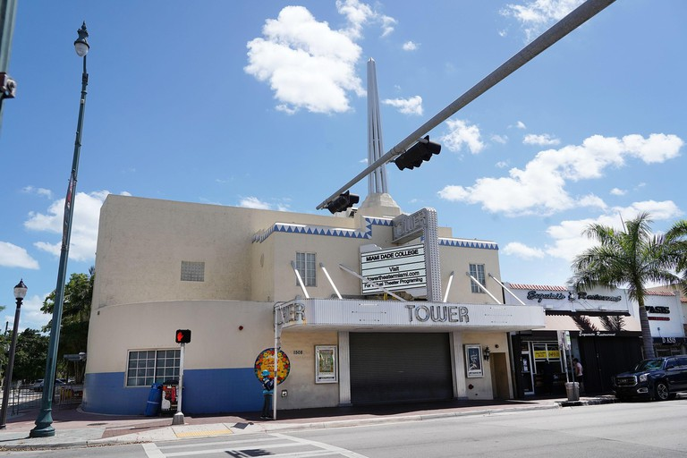 """MIAMI, FL - APRIL 28: General view of the Tower Theater at world famous """"Calle Ocho"""" in Little Havana during the coronavirus pandemic on April 28, 2020 in Miami, Florida. Starting April 29 Miami-Dade County will open public parks, marinas and golf courses"""