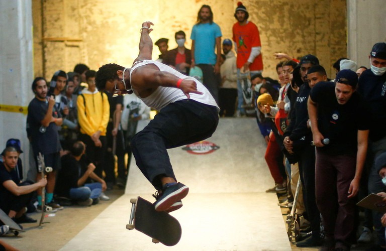 A skateboarder competes at the Red Bull Mind the Gap first skateboarding event in Egypt, inside the Townhouse Gallery near Tahrir Square, amid the coronavirus disease (COVID-19) pandemic, in Cairo, Egypt February 27, 2021. Picture taken February 27, 2021.