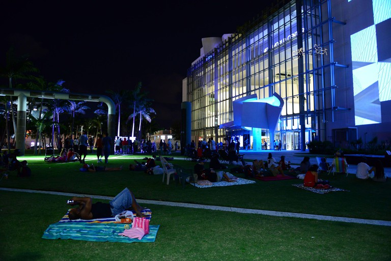 Miami Heat fans attend the watching of a??Together We Risea? Movie Premiere WALLCAST and the display of Miami Heat's LeBron James, Dwyane Wade and Chris Bosh 16 to 20 feet Big 3 larger than life statue leading to Tuesdaya??s regular-season opener at New