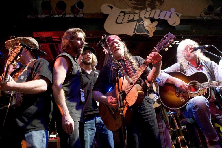 17 December 2005 - New Orleans, LA - Tipitina's, New Orleans, Louisiana. Arlo Guthrie and friends Ridin on the city of New Orleans tour benefiting Musicares Hurricane relief 2005 sponsored by Amtrak. (rt) Arlo Guthrie and Willie Nelson (2nd rt) wrap up th