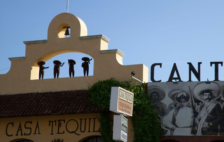 Small figures on top of a tequila bar, Cancun, Mexico