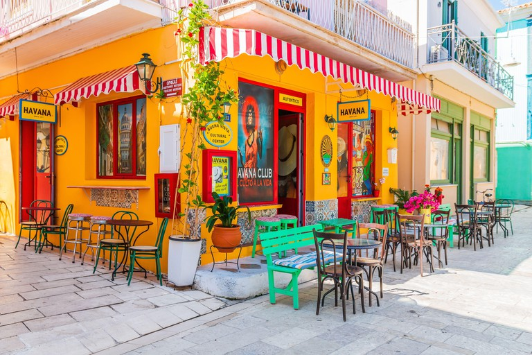 Lefkada, Greece - July 20, 2020: Street bar in the old town of Lefkada city.