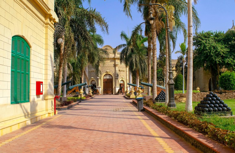 Cairo - Egypt - October 4, 2020: Presidency museum entrance with alley in the inner courtyard with old cannons. Facade of Abdeen Royal Palace, located