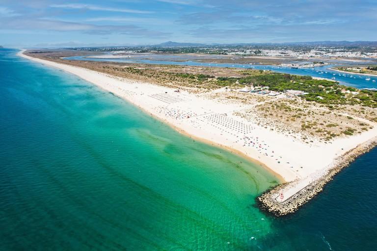 Aerial view of the Tavira Island beach, a tropical island near the town of Tavira, part of the natural park of Ria Formosa in Algarve region of south