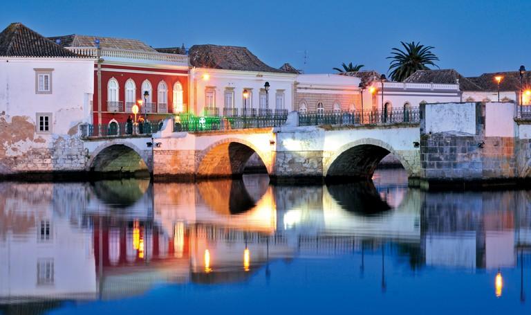 Portugal, Algarve: View of the old bridge Ponte Velha in Tavira