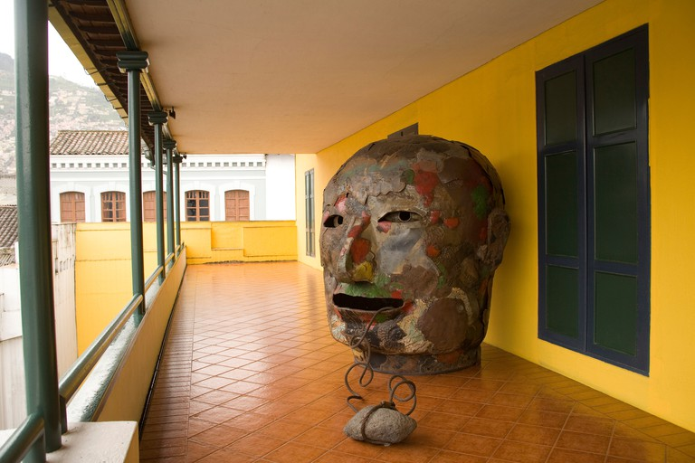 South America Ecuador Pichincha province Quito. Modern sculpture on porch of Museum of the City  in old town colonial district.