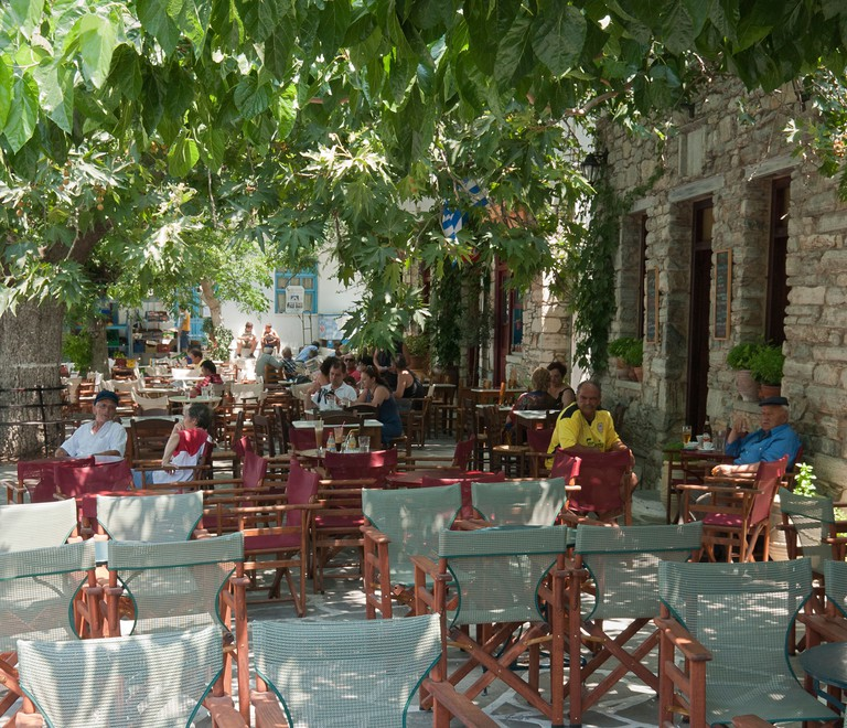 Tree shaded cafe in Filoti village on Naxos Island, Greece. Image shot 2009. Exact date unknown.