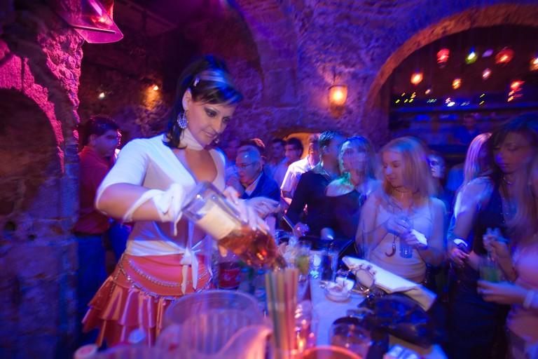 BKYBDE Young woman preparing drinks in the nightclub Hamam Club, Kos-Town, Kos, Greece