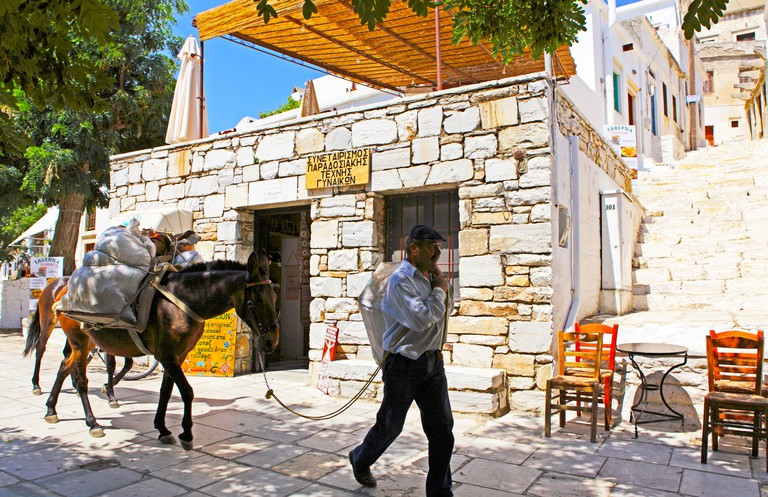 BNBTBC Man with a mule at the mountain village Apeiranthos, Island of Naxos